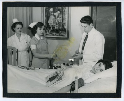 Student nurses and doctor with a patient.