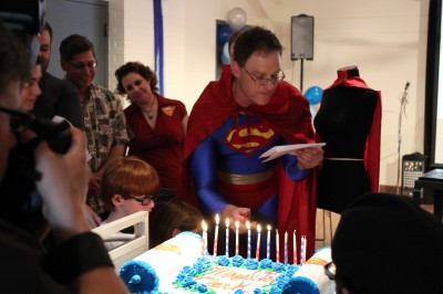 Superman lighting his candles