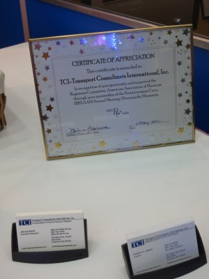 Reinforcement Crew sponsor TCI proudly displays their certificate of recognition from the Registrar's Committee at their booth in the Expo Hall.