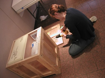 Jobi preps a packing crate