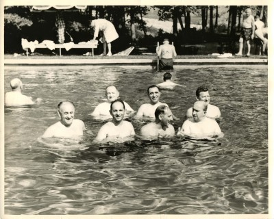 A group of seven men from the Jewish Laymen's Institute in a swimming pool. Front row, left to right: Jerry Dennenberg, Frank Sigelman, Buddy Sigelman, unidentified. Back row, left to right: unidentified, unidentified, unidentified (1992.202.78)