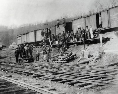 A young Saul Bernstein stands in a group of peddlers and railroad workers in the town of Bluefield, West Virginia.