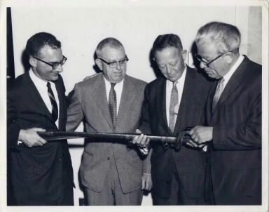 Presentation of Leopold Blumenberg's swords  to the Jewish Historical Society of Maryland, May 1, 1962. Pictured are (left to right): Edwin Wolf II of Philadelphia, Dr. Harry Bard-Vice President of Jewish Historical Society of Maryland, Hugo Dalsheimer-President of Jewish Historical Society of Maryland, Dr. Isaac M. Fein-Curator of Jewish Historical Society of Maryland.