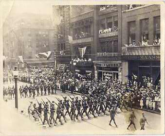 Troops parade down Baltimore Street near Calvert in 1918.  Parades and other festivities would have helped stir patriotism and promote cohesion among Americans.  Perhaps these young men were new recruits marching off toward their training bases, or maybe they were heading directly toward the war in Europe, either way, this celebration and apparent support from the civilian population must have bolstered them. Courtesy of Stanford C. Reed. 1987.19.22