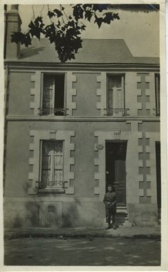 Stanford Z. Rothschild, Sr. in front of his billet (the Rifand family home) in Tours, France during his service in World War I, 1918.  Stanford immigrated to America as a child with his parents. Courtesy of Stanford Z. Rothschild. 1991.127.20