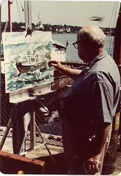 Edward Rosenfeld painting a water scene while standing on a dock, n.d.  Courtesy of Licien Harris. 1998.147.5.13