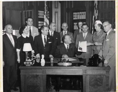 Photograph of Gov. Theodore R. McKeldin signing a proclamation designating the week as American Jewish Congress Week, November 1956.  Pictured from left to right are:  Meyer Cardin, Gertrude Benesh, Irvin Kovens, Maurice Cardin, Judge Daniel Friedman, Isaac Taylor, Gov. Theodore R. McKeldin, Otto D. Weill, Senator Philip H. Goodman, Florence Rogers, and Samuel Steinbach. Courtesy of Jack L. Levin. 1984.3.43.