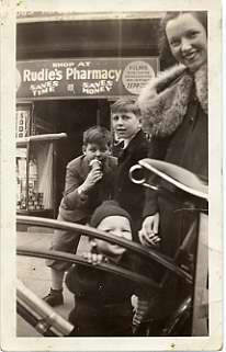 Hilda (Lapides) Rudy and Sheldon Rudy (infant), November 1, 1936. Taken in front of Rudie's Pharmacy, 3100 Block of West North Avenue. Courtesy of Bessie Franklin. 1989.78.7.