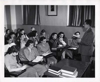 Hymen Saye teaching 'Introduction to Hebrew' at the College of Jewish Studies, November 1947. Rhoda (Goldstein) Wilkis is in the front row, third from left, and Doris (Pollack) Schnider is fourth from left, wearing a dark dress, looking at the teacher. Courtesy of Hymen Saye. 1991.7.30.