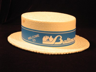 White Styrofoam boater-style hat used by the donor as a delegate at the UAHC convention in Baltimore, 1991.  Courtesy of E.B. and Allan T. Hirsch, Jr. 1992.190.1.