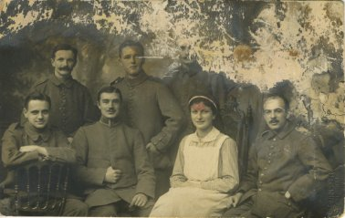 Group of men in the German army during World War I with Gertrude Strauss (nurse) taken at a hospital in Karlsruhe, Germany.  Isidor Maier (donor's father) is in the upper corner of picture. Courtesy of Meta Oppenheimer. 1998.74.1