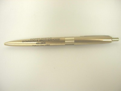 One of three pens from the Rogers Avenue Synagogue Brotherhood,  Fathers Day, 1984. Gold colored metal, ball points.  Courtesy of Morris Cohen. 1993.52.223a.