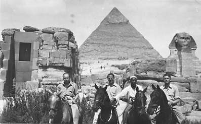 Harry Greenstein and other unidentified men in front of a pyramid while working for the United Nations Relief and Rehabilitation Administration, 1944.  1996.033.008a