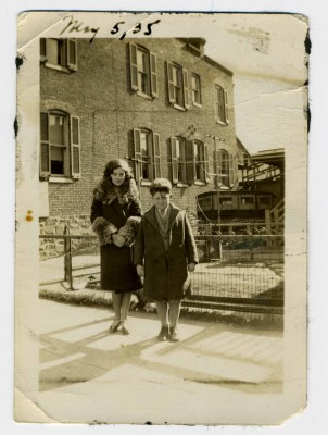 Fourteen-year-old Morty Weiner and his sister Ruth, 19, visiting their aunt in the Jewish neighborhood near Druid Hill Park, May 1935. CP 5.2013.1