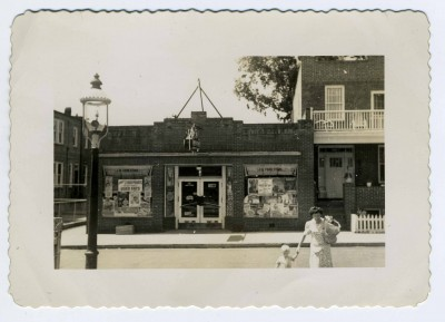 J.M. Food Store, owned by Morty Weiner's father Joseph, located on Polk Street near Harford Road in Northeast Baltimore, circa 1940. The Weiner family lived in the house next door. CP 5.2013.2