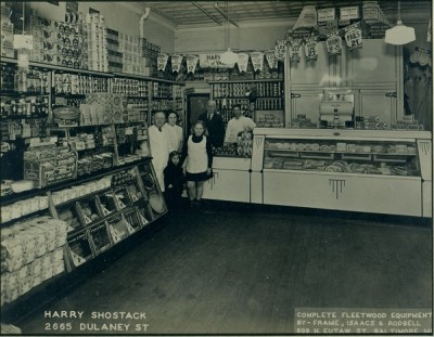 The Shostack store on Dulaney Street in Southwest Baltimore, circa 1937. Back row: Harry and Mary Shostack, Mary's father Wolf Kotzen, and store employee Carl Warfield. Front row: Debby and Harriet Shostack.
