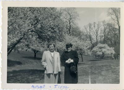 "1985.046.003 – Two women standing in front of cherry blossoms in Druid Hill Park, 1953 with the inscription ""mother and Irene"""