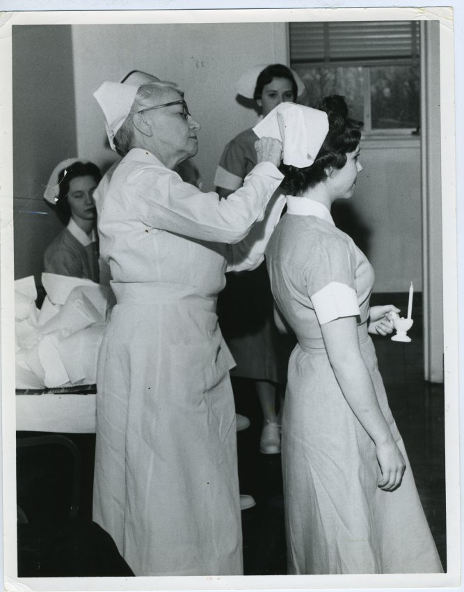 A Nurse Possibly Molly Roseman Pinning A Cap On A