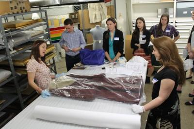Handling textiles.