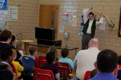 Grant Cloyd performs as Saul Bernstein for excited students.