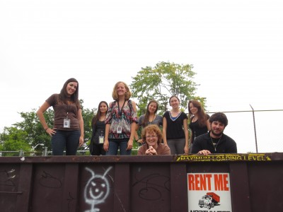 "2013 Summer interns [Front Row] Clare, Erin, Kathleen, Todd [Back] Kathy, Marissa, Elaine, Trillion had so much fun at the dumpster party, we took their ""class picture"" inside the dumpster."