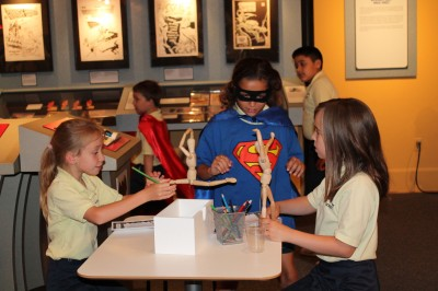 "A school group enjoys our hands-on ""artist studio."""
