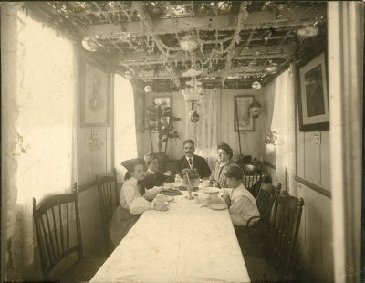 1994.206.001 – This is one of our earliest Sukkot related photos taken in 1904 of the Lutsky Family eating in their sukkah.