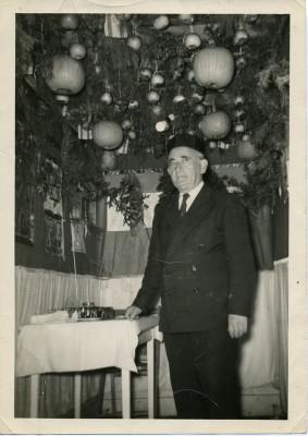 2003.104.003 – Samuel D. Miller standing inside the sukkah behind Beth Sholom in Frederick