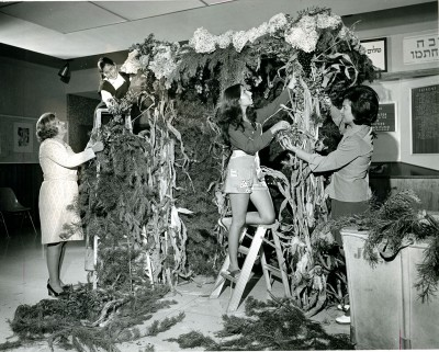 2006.013.1062 – In this photo from 1974 women decorate a sukkah at the JCC. Looking for creative decorating ideas – check out these fun project ideas: pinterest.com/kosheronabudget/sukkah-decorating-ideas/
