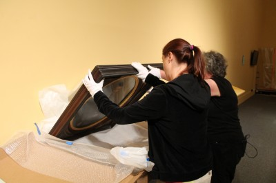 Now that they are handling the frame of a painting, Jobi and Bonni-Dara have on their white gloves.
