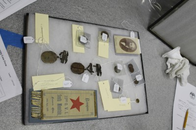 You'll  have to come to the Passages Through the Fire exhibition to learn about the individuals who wore these medals and badges.
