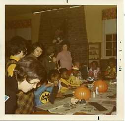 A National Council of Jewish Women member helps out at a Halloween party at Sinai Hospital.