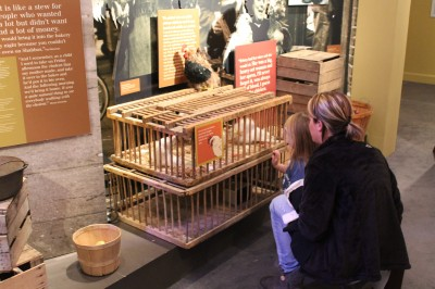 Looking into the chicken cage in the market section of Voices of Lombard Street.