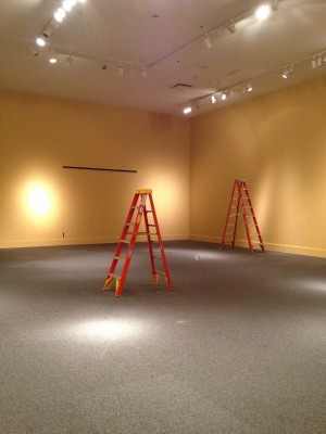 It all starts with an empty gallery and a ladder.