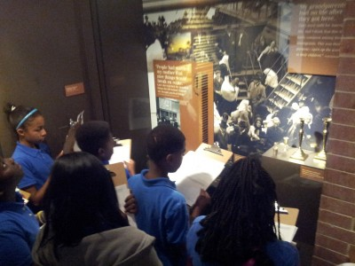 Searching through the Voices of Lombard Street exhibition while on a scavenger hunt (Photo courtesy of Mr. Kaiser).