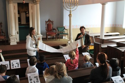 Students viewing a copy of the Torah.