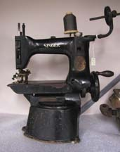 1997.149.003  Button sewing machine (1930s), made by Singer, from D. Schwartz and Sons Garment Machinery Co., of Baltimore Street and later, Gay Street.