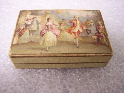 2004.106.003b Small cardboard box with colorful image men and women in 19th century costume, from Wilhelm Bottler Juwelier Gold & Silberarbeiter Rothenburg Tauber. Box contains 1848 gold ducat given to Rabbi Benjamin Szold. This is not the original box that the gold ducat was kept it. The box was, however, part of Rabbi Szold's wedding gift.