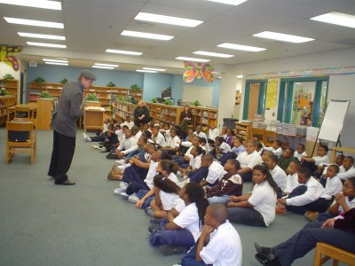 Actor Tim King portraying Saul Bernstein at a performance for Cross Country Elementary students