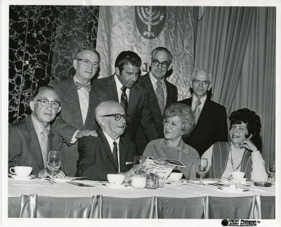 Ten people called to identify the attendees at Samuel Neistadt's 60th birthday party. Seated Left to Right: 1. Reuben Livov 2. Samuel Neistadt  3. unidentified 4. Doris Weikers Kahn Standing Left to Right: 1. Hyman Winnik 2. Carl Friedler  3. Jacob Jaffe 4. Isaac H. Taylor. Thanks Susan Weikers Balaban, Fay Adler, Dorothy Livov, Barbie (Livov) Weiss, Ronald Taylor. Richard Taylor, Deborah Taylor, Bruce Taylor, Ellen Friedler Eisenstadt, and Norma Wollod!