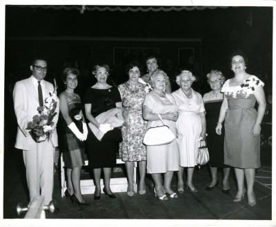Callers provided a few clues about these Hadassah ladies. Left to Right:  1. [man] unidentified 2. unidentified 3. unidentified 4.  Brownie Cummings (past president of Hadassah) 5.[standing behind] possibly Sarah Kapiloff 6.____ Grief 7. Sara Jacobs 8. Jenny Ehrlich 9. unidentified