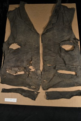 "A ""mended"" 19th century men's vest with pockets."