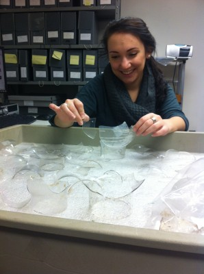 Intern Molly works to mend glass oil lamp chimneys.