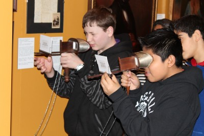 Students from John Ruarah explore our photography interactive station.