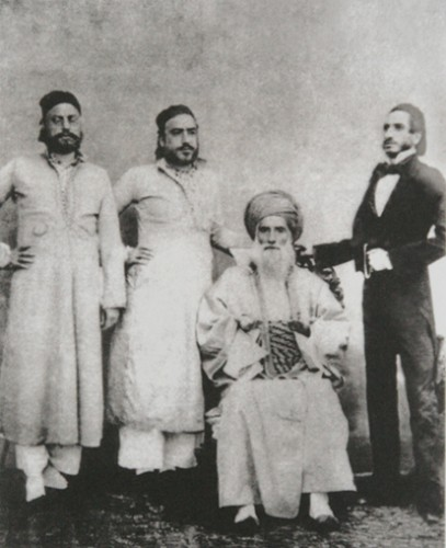 David Sassoon (seated) and his sons Elias David, Albert (Abdallah) & Sassoon David. Image via wikipedia.