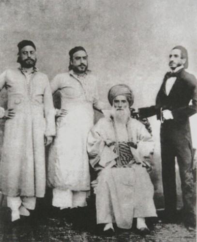 David Sassoon (seated) and his sons Elias David, Albert (Abdallah) & Sassoon David. Image via wikipedia.