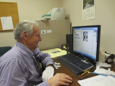 Volunteer Marvin Spector scans photos faster than we can attach them!
