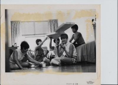 A group of Sinai nurses in gathered in their residence eating pizza, no date. Courtesy of Sinai Hospital of Baltimore.