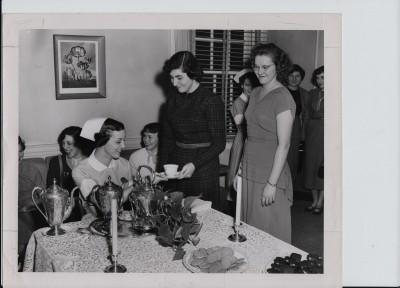 Sinai nurses drinking from their silver tea set, no date. Courtesy of Sinai Hospital of Baltimore.