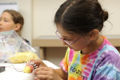 Testing the difference between insulating and conductive play dough.
